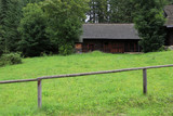 Wooden fence on meadow - 232305409