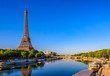 View of Eiffel Tower and river Seine at sunrise in Paris, France. Eiffel Tower is one of the most iconic landmarks of Paris - 232305869
