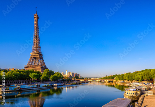 View of Eiffel Tower and river Seine at sunrise in Paris, France. Eiffel Tower is one of the most iconic landmarks of Paris © ekaterina_belova