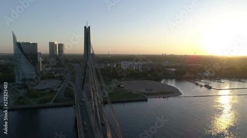Aerial drone shot of suspension bridge during sunset in Riga, Latvia