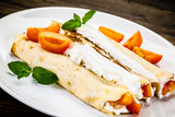 Sweet crepes with apricots - 232331257