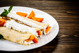 Sweet crepes with apricots - 232331409
