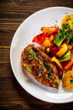 Grilled chicken fillet and vegetables on woowde table - 232332214