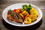 Grilled chicken fillet and vegetables on woowde table - 232332264