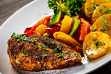 Grilled chicken fillet and vegetables on woowde table - 232332602