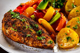 Grilled chicken fillet and vegetables on woowde table - 232332643