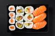Leinwandbild Motiv Japanese food: maki and nigiri sushi set on black background. Top view