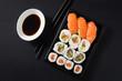 Maki and nigiri sushi set on black background - 232336456