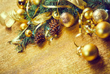 Christmas tree branch with gold balls and ribbons - 232343093