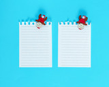 two white blank sheet in a line torn out of notepad - 232362678