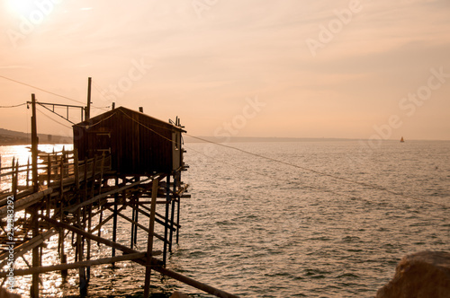 pier on stilts for fishermen - 232383292