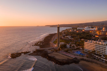 Aerial view of the Gran Canaria island during sunset. Beautiful beach near Maspalomas dunes and Meloneras district.  © ingusk