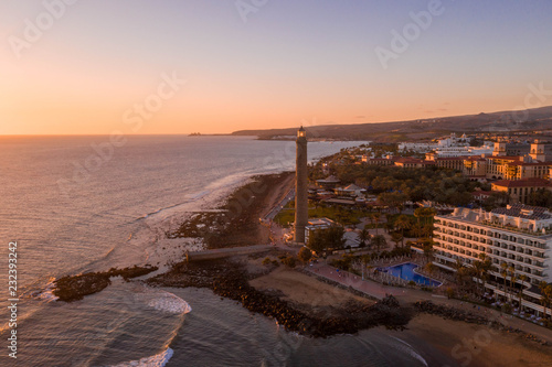 Aerial view of the Gran Canaria island during sunset. Beautiful beach near Maspalomas dunes and Meloneras district.  - 232393242