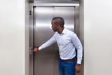Man Pressing Elevator Button - 232399206
