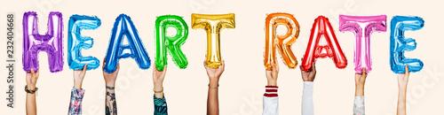 Leinwanddruck Bild Hands showing heart rate balloons word