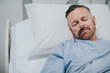 Leinwanddruck Bild - Sick man in a hospital bed