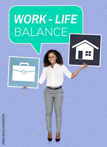 Leinwanddruck Bild Businesswoman looking for a work life balance