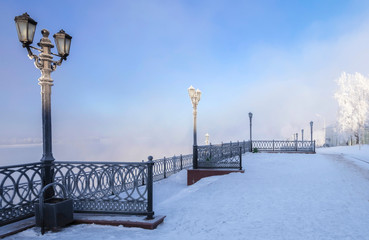 Volga River Embankment in the city of Uglich in the frosty winter afternoon. © Dmitry