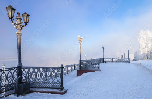 Fridge magnet Volga River Embankment in the city of Uglich in the frosty winter afternoon.