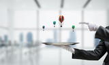 Hand of waiter presenting balloons on tray. - 232428218