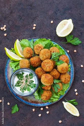 Poster Homemade falafel made from chickpeas, on salads.