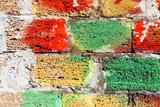 Old white stone wall with colorful paint - 232439040