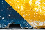 Grungy concrete road block, yellow and blue - 232439085