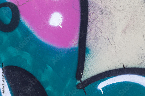 Abstract graffiti fragment over gray wall