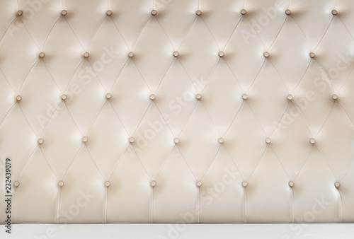Soft headboard and white bedding sheets