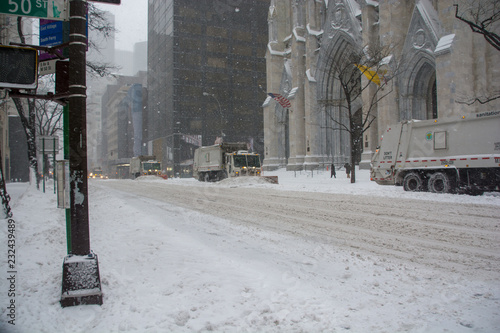 fototapeta na ścianę New York City blizzard of 23rd January 2016 showing streets covered in snow with snow plough but no traffic