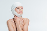 nude woman with bandages on head after plastic surgery isolated on white - 232448235