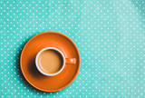 orange cup of coffee with milk on polka dot background. Above view - 232455882