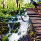 Splendid morning view of Plitvice National Park. Colorful spring scene of green forest with pure water waterfall. Great countryside landscape of Croatia, Europe. Beauty of nature concept background.