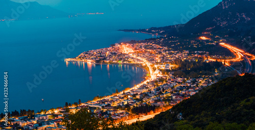 View from the bird's-eye of Kamena Vourla town in the evening light. Colorful spring cityscape in Greece, Europe. Beautiful sunset on Aegean Sea. Traveling concept background.