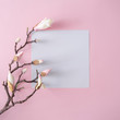 canvas print picture - White and pink flowers on pastel pink background with paper card note. Minimal flat lay top view composition.