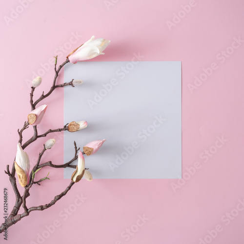 canvas print picture White and pink flowers on pastel pink background with paper card note. Minimal flat lay top view composition.