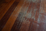 Old scratched hardwood flooring in need of maintenance. parquet ruined by scratches made by prolonged use of chair. - 232482083