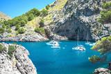 The best beach with turquoise water on island Palma Mallorca, Spain. Beautiful view on sailing boats yachts destination Sa Calobra Torrente de Pareis, island of Majorca Balearic islands Spain - 232488203