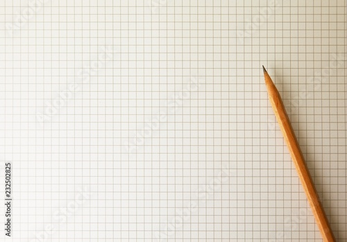 drafting paper or graph paper with pencil under warm incandescent