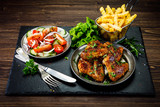 Roast chicken wings with french fries and vegetable salad  - 232504265