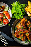 Roast chicken wings with french fries and vegetable salad  - 232504631