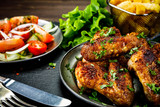 Roast chicken wings with french fries and vegetable salad  - 232504699