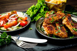 Roast chicken wings with french fries and vegetable salad  - 232504834