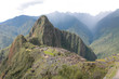 Machu Picchu with rain in valley behind
