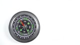 Black compass rotating on white background. Travel, tourism and exploration. Top down view - 232533424