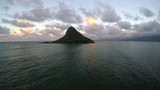Using a drone to quickly approach China Man's Hat in Oahu, Hawaii near Kualoa Ranch. - 232539860