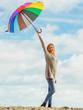 Happy woman holding umbrella