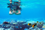 Woman at snorkeling in turquise sea water - 232542820