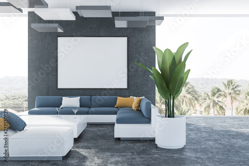Black living room, blue sofa and banner