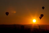 hot air balloons at sunset - freedom and adventure concept - 232555292